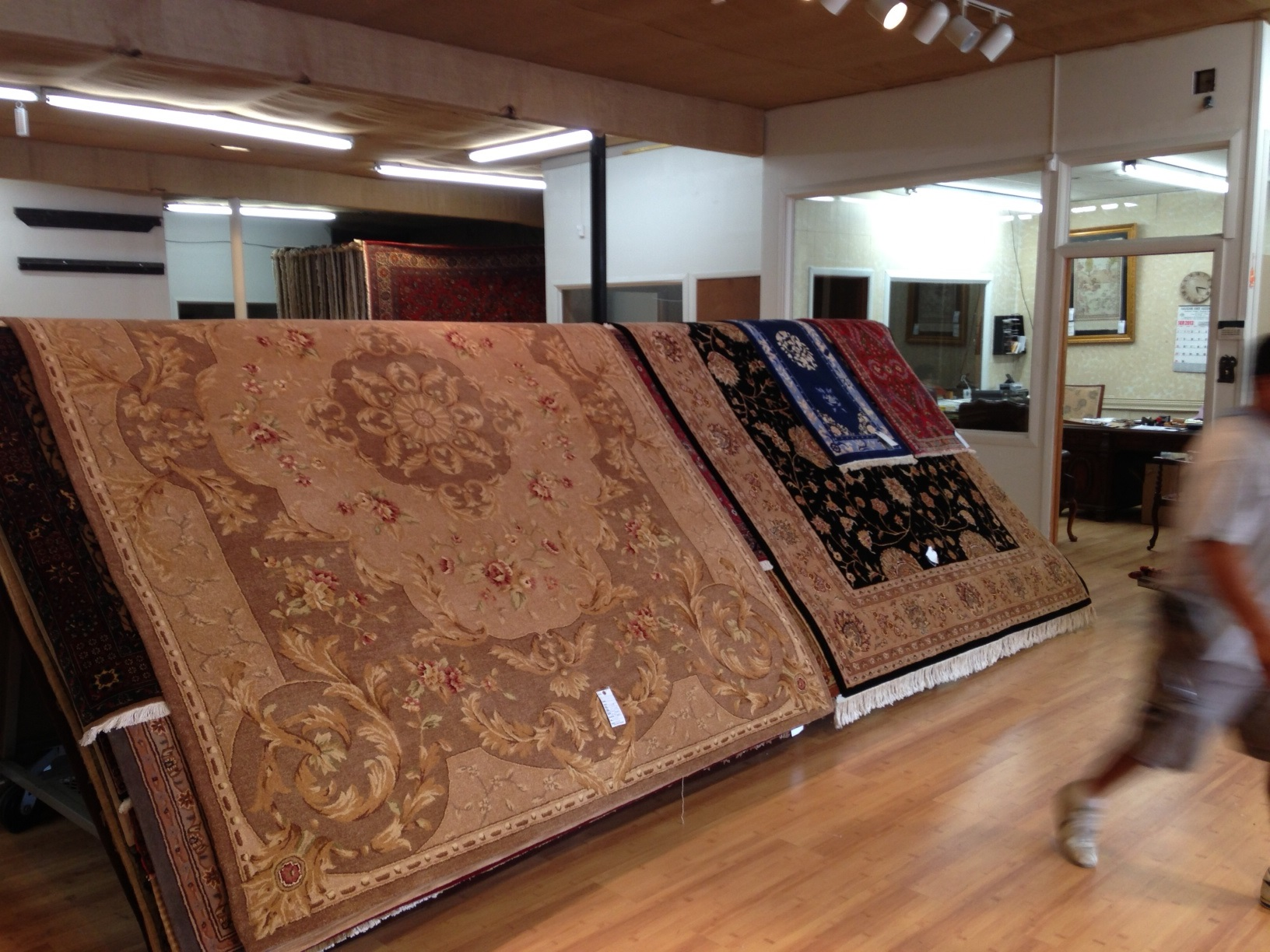Racks for rugs at the auction!